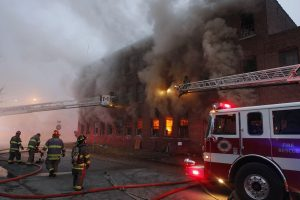 Herald & Review, Jim Bowling Decatur firefighters work a large fire at the Action Equipment Building on East Grand Avenue and North Illinois Street in Decatur, Ill., Wednesday January 21, 2015.